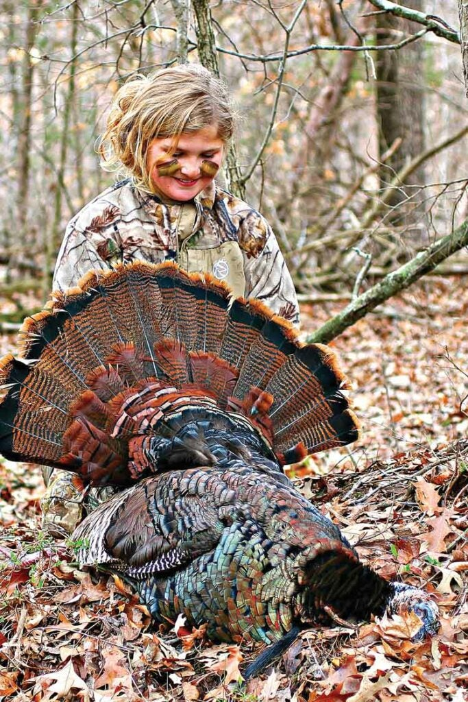 young girl turkey hunting