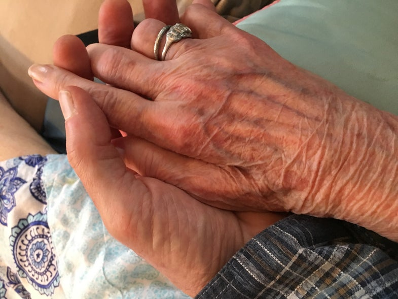 bill heavey holding his mother's hand