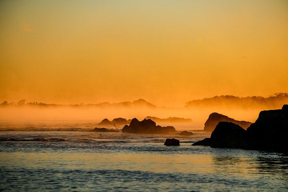 a golden sunset over the upper parana river