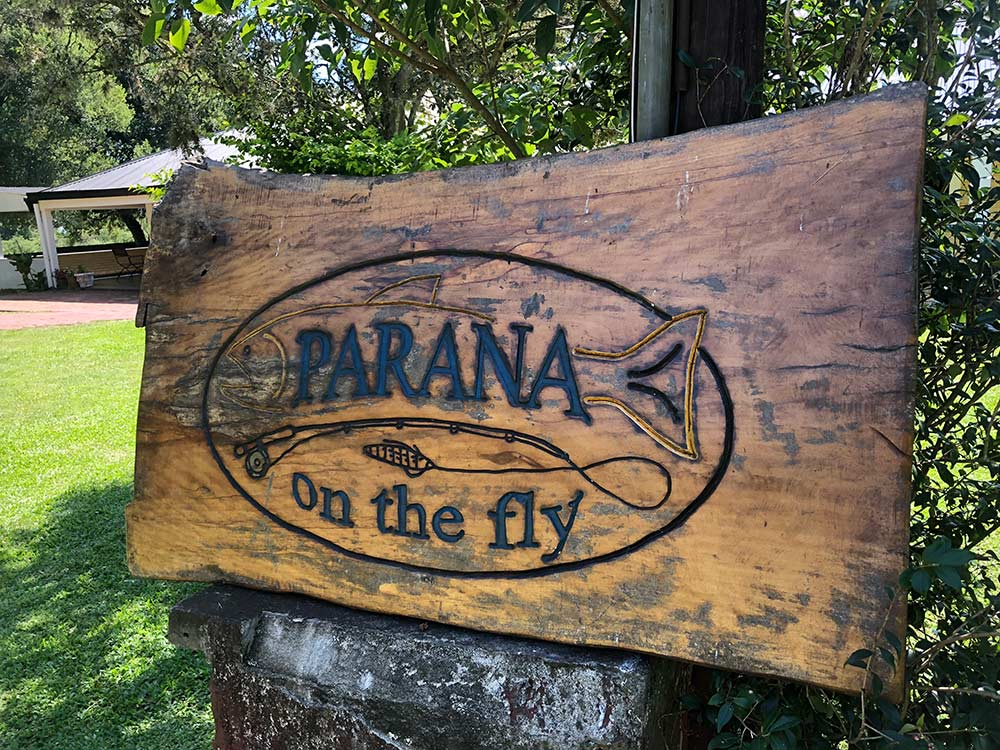 wooden sign at parana on the fly