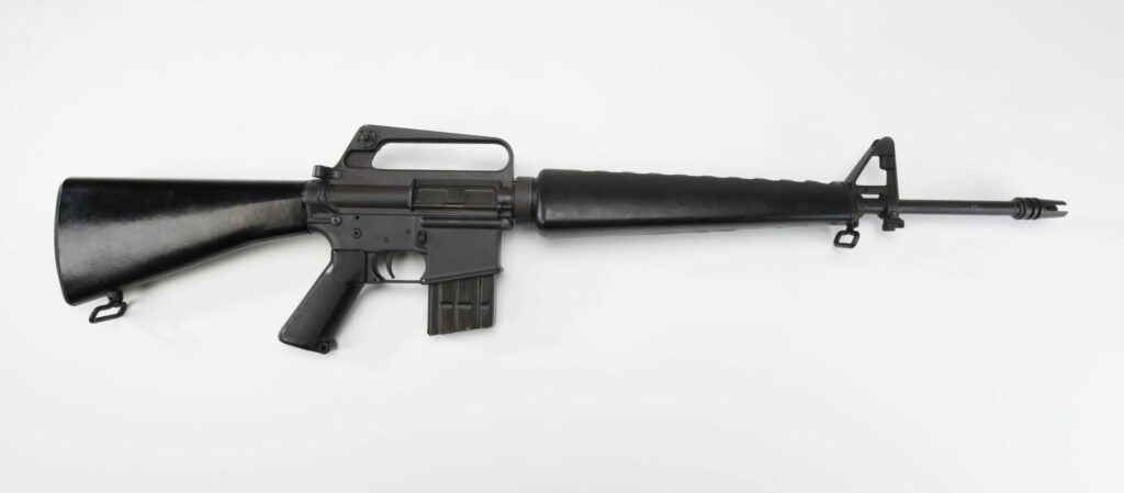 An AR-15 rifle on a white background.