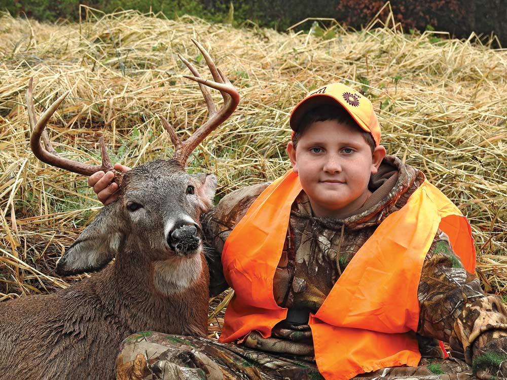 young boy whitetail hunting buck kentucky