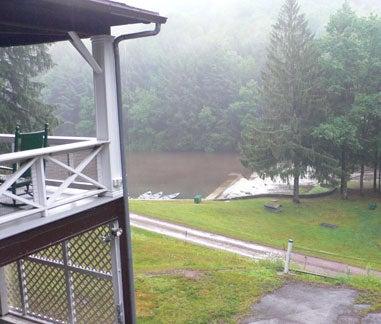 view of rain on cabin porch