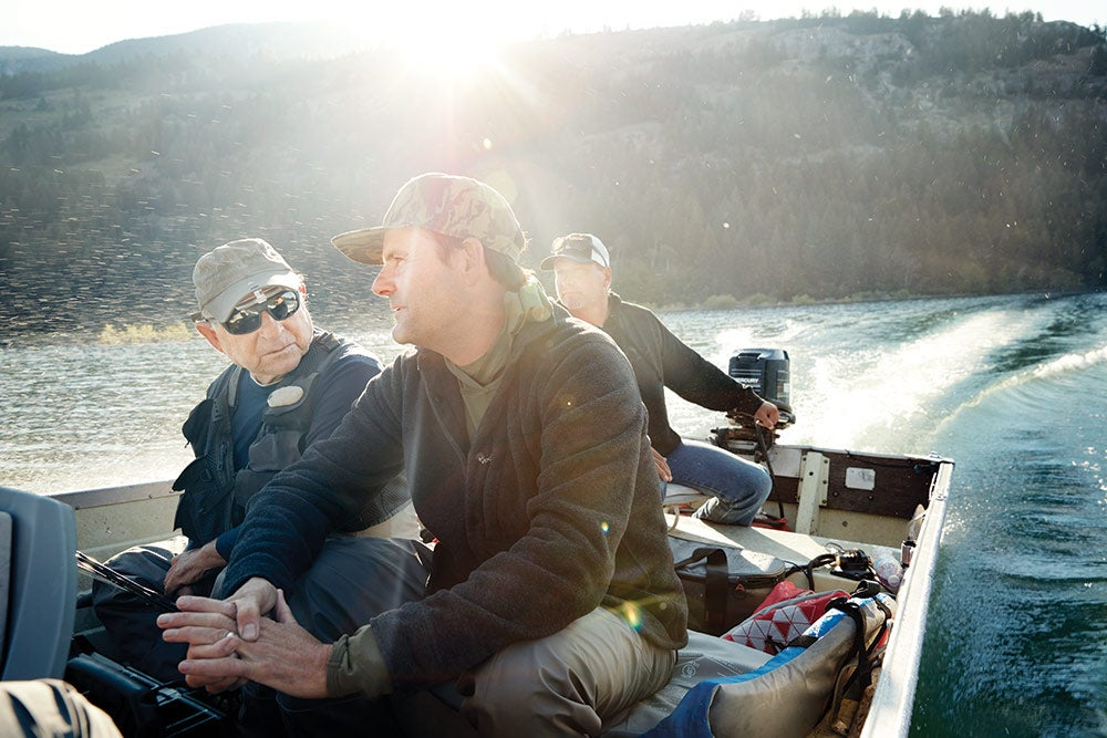 yvon chouinard and kenton carruth riding in boat