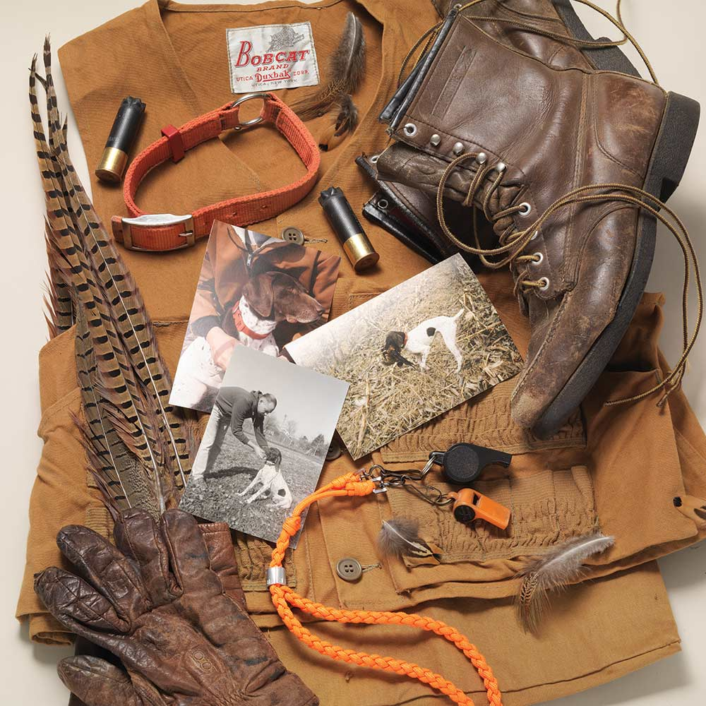 hunting gear and photographs of hunting dog