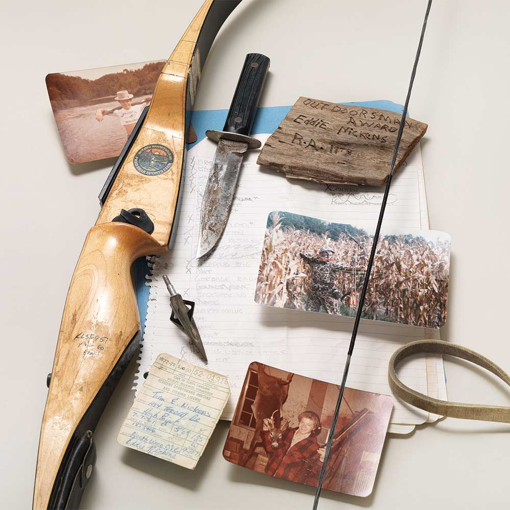 collection of hunting gear and old photographs