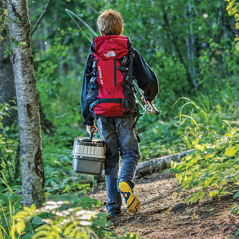 kid walking fishing gear