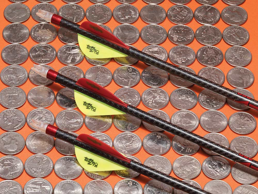 arrows sitting on rows of quarters