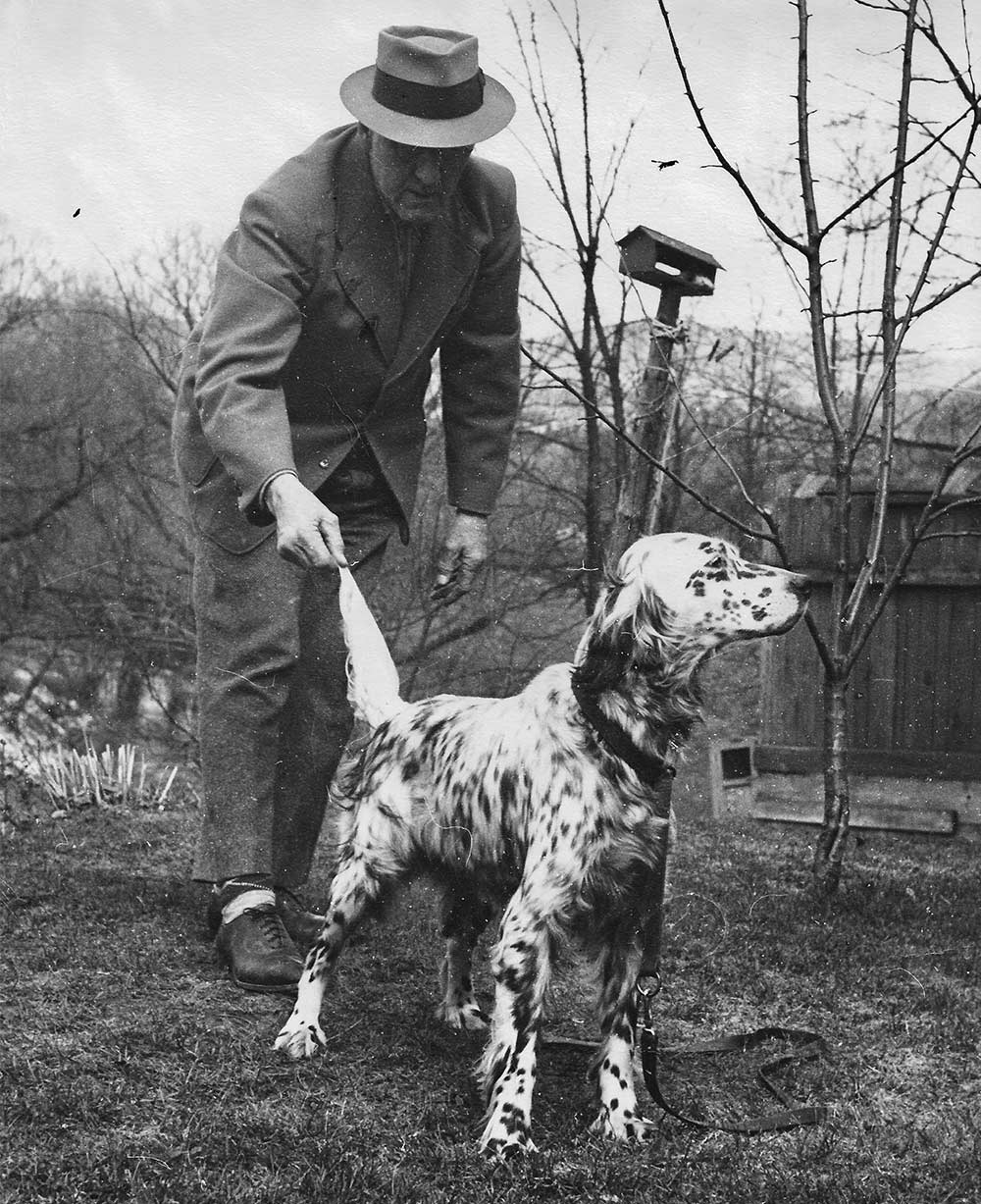 black and white photo of earl twombly and hunting dog