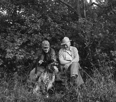black and white photo of corey ford and hunting dog