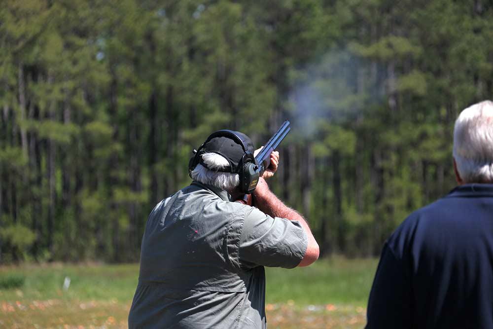 older man shooting skeet
