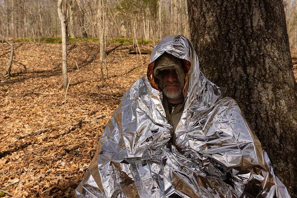 man wrapped in a warm emergency blanket