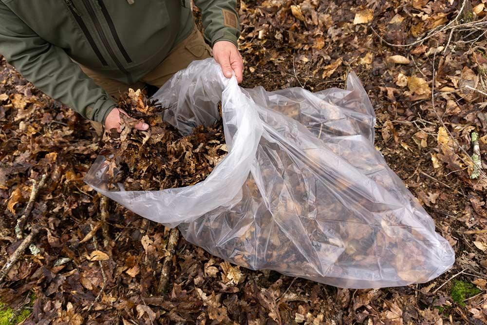 garbage bag full of leaves