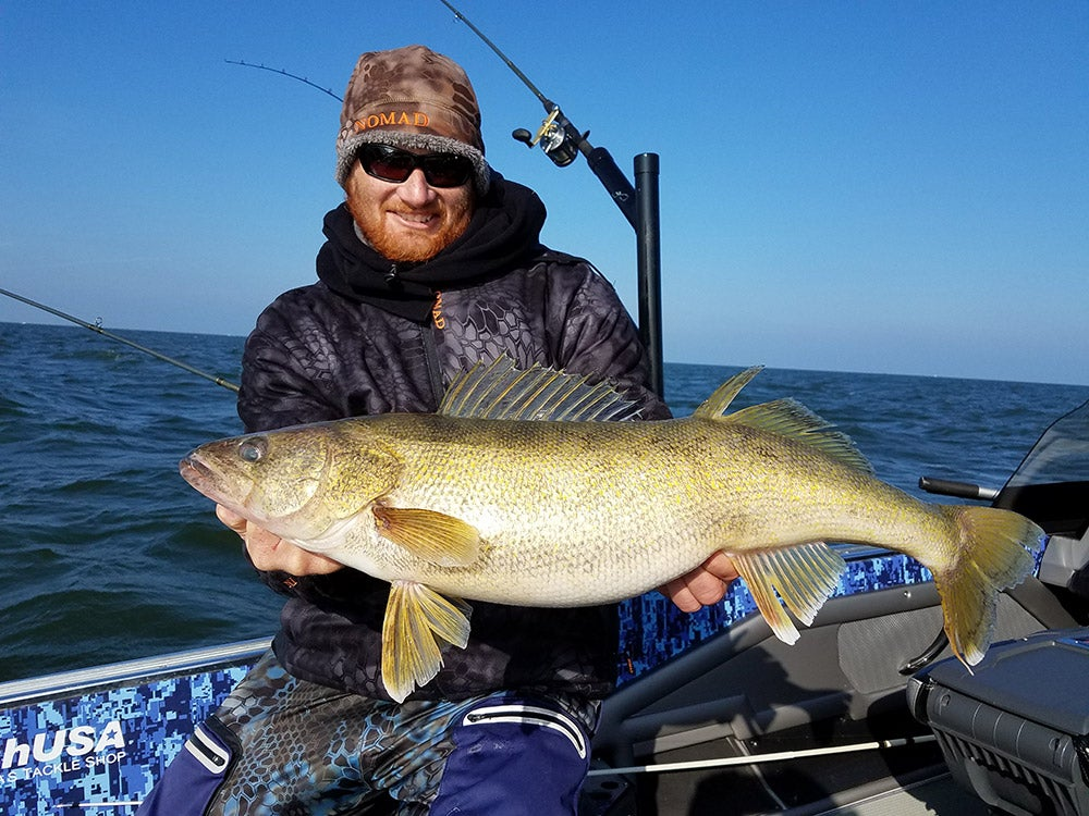 fisherman holding up a giant walleeye