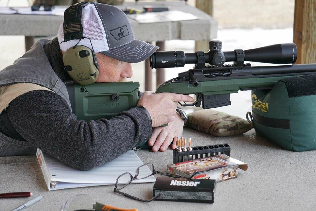 aiming a rifle while testing ammo