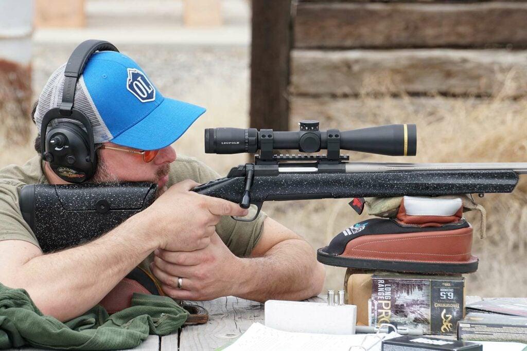 man aiming a hunting rifle