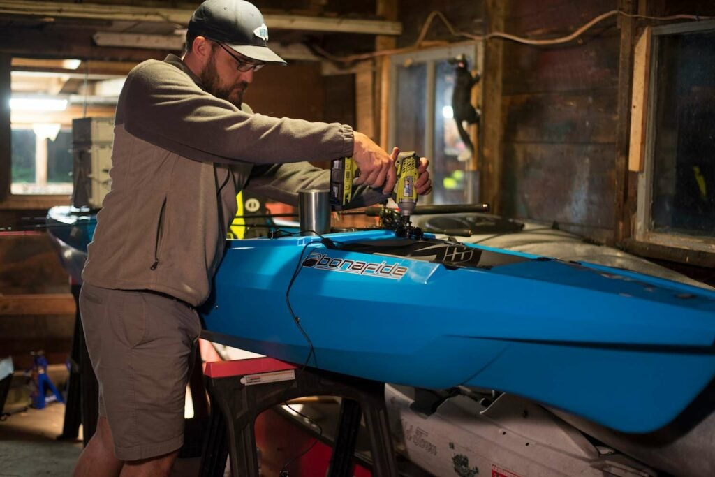The author rigs gear on the Bonafide Kayaks EX123.