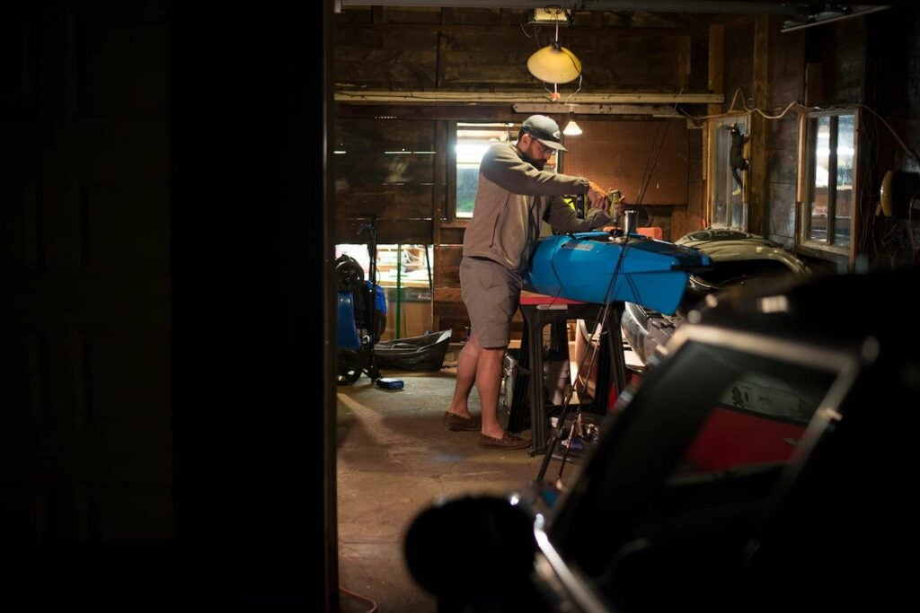 SEO Editor Ben Duchesney rigging a fishing kayak.