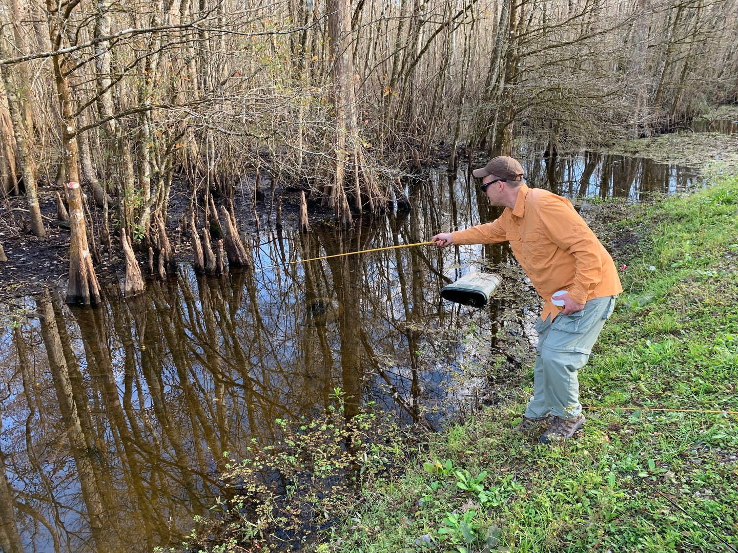 an angler fishing in a small ditch