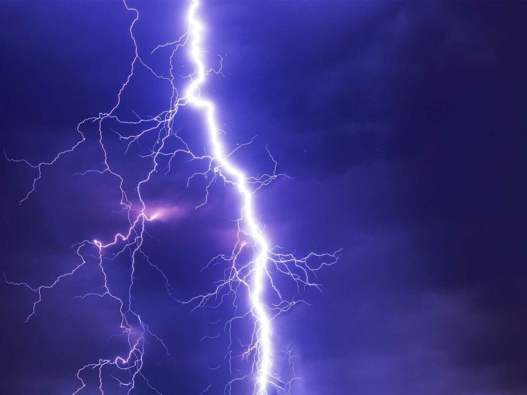 a lightning strike across a purple sky