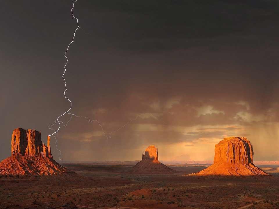 a lightning storm over an arizona mesa