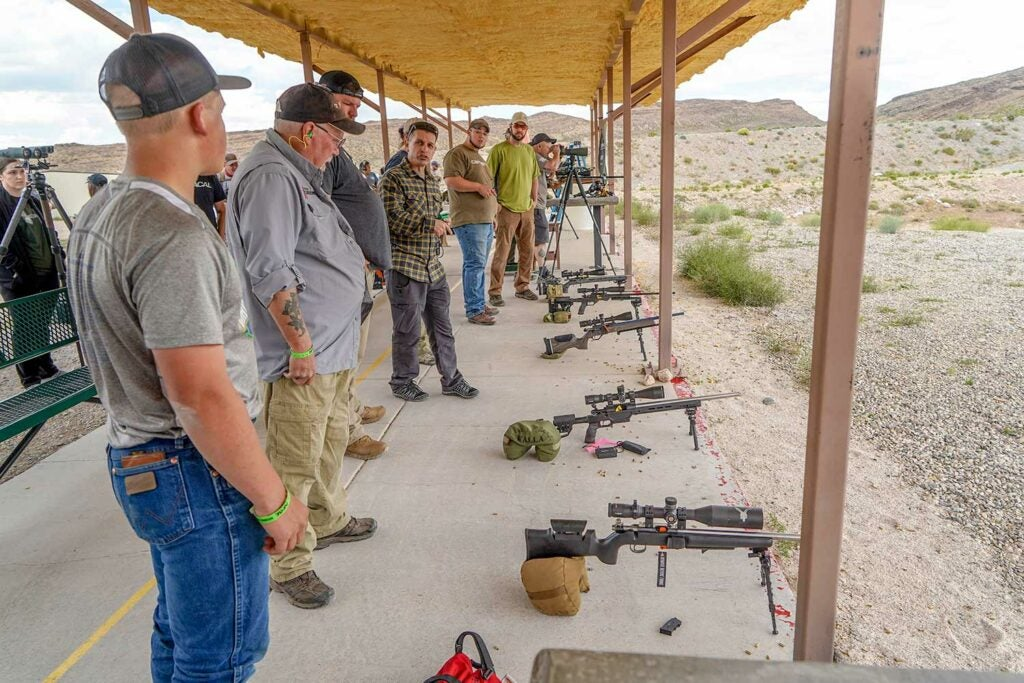 group of people standing in a shooting range