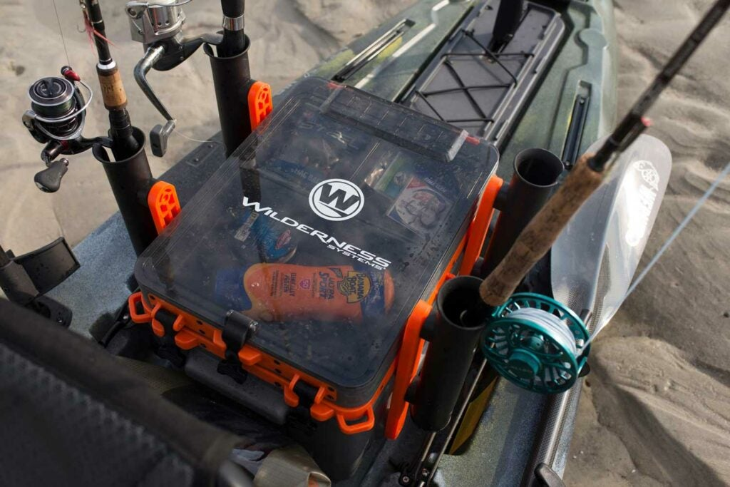 The Wilderness Systems Kayak Krate full of gear and fishing rods.