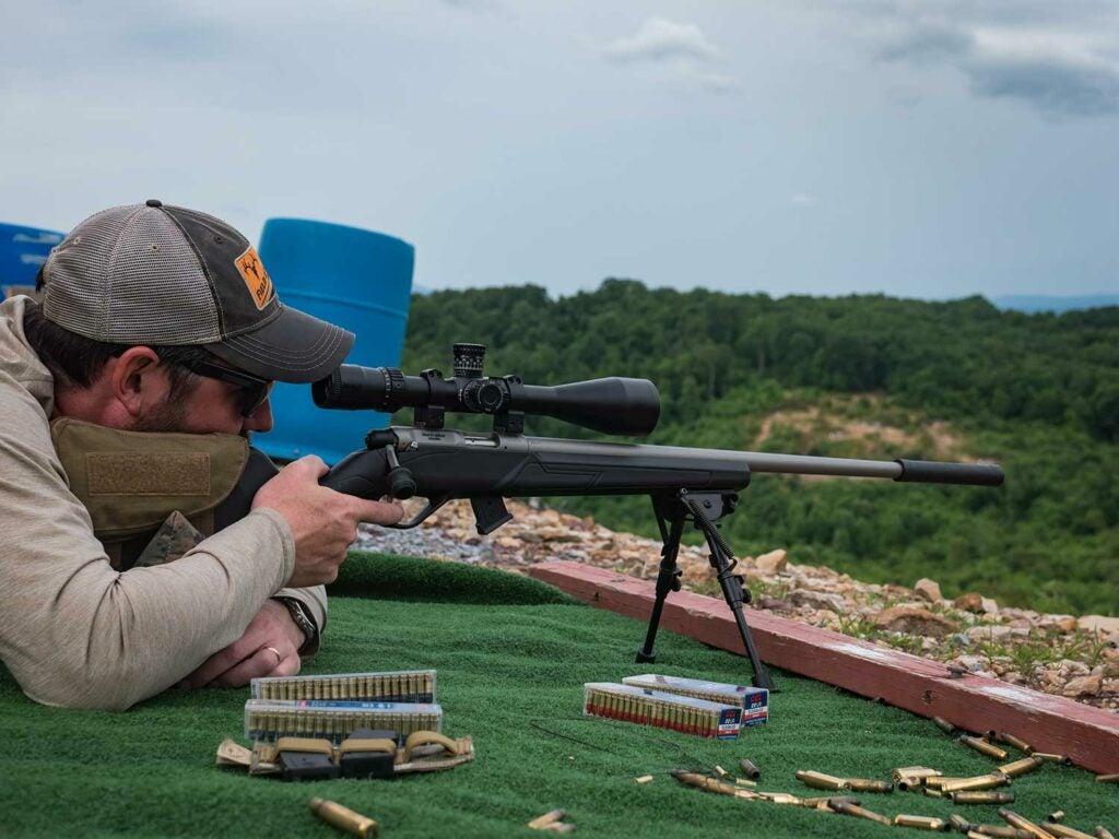 michael r shea aiming a rifle
