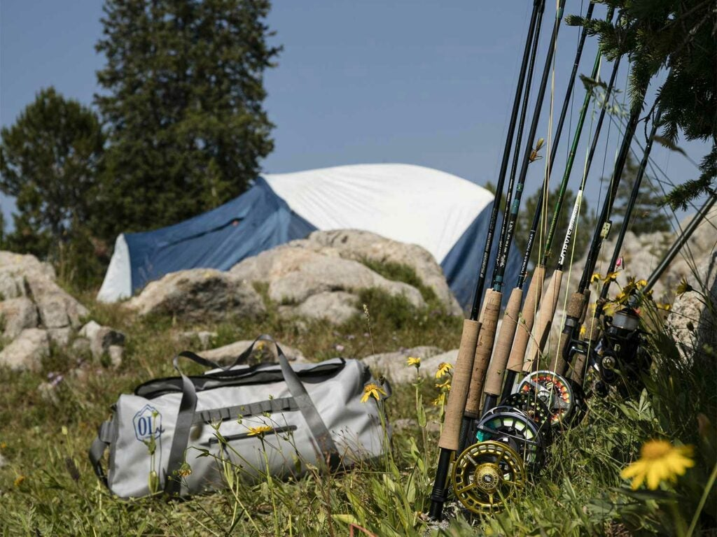 tent and fishing rods outside