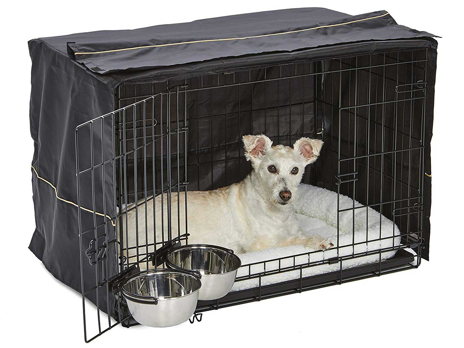 dog in a covered dog crate