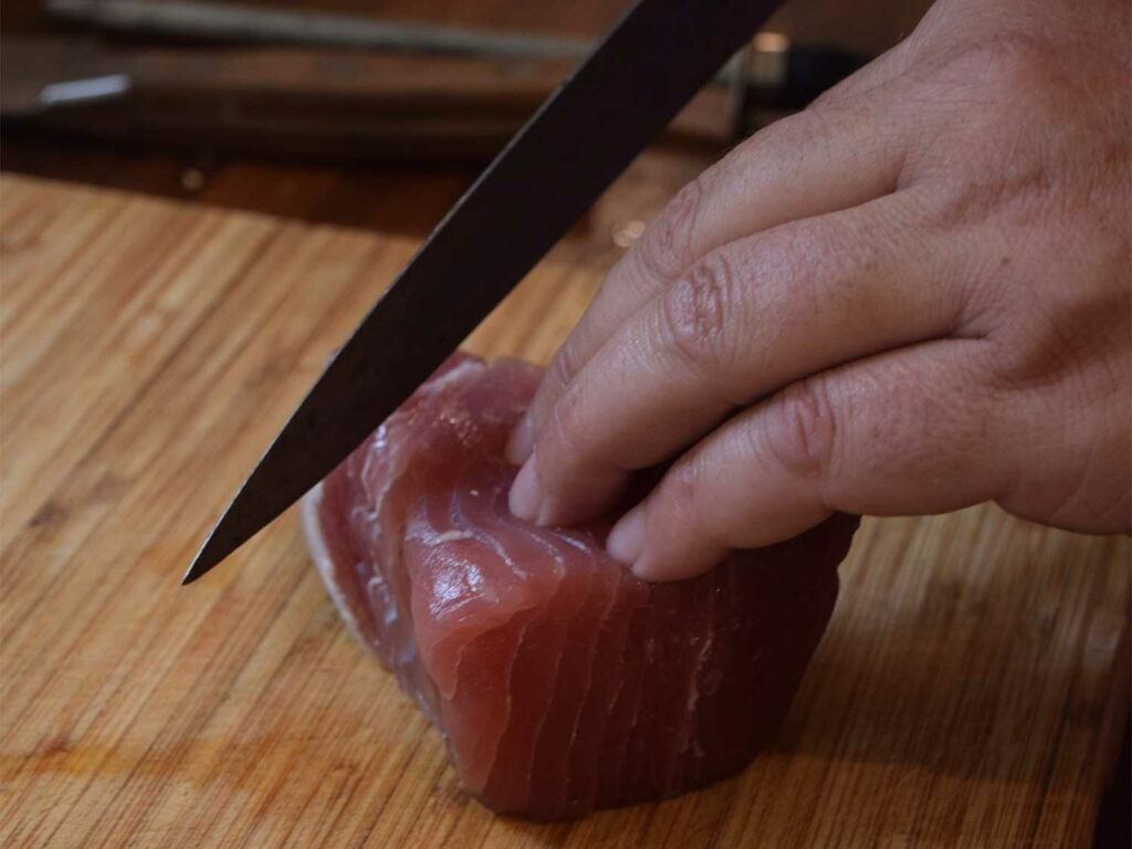 slicing blackened tuna sashimi