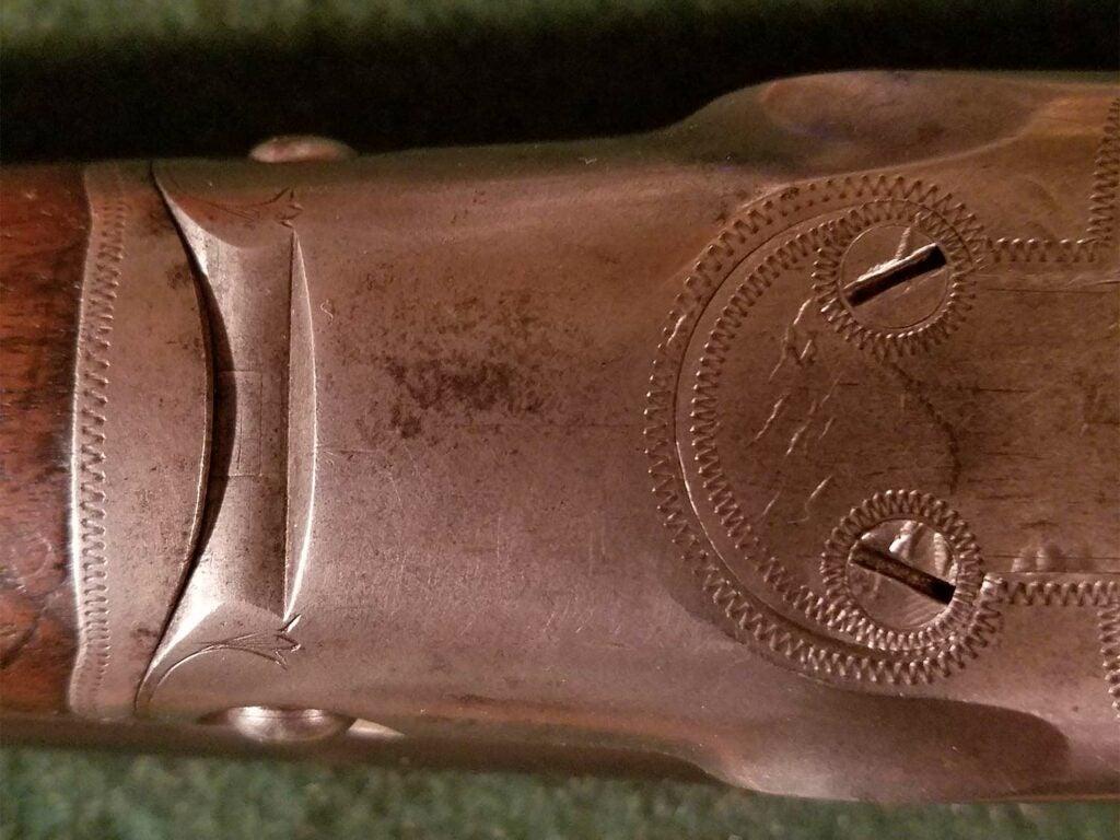 mangled screws on a shotgun