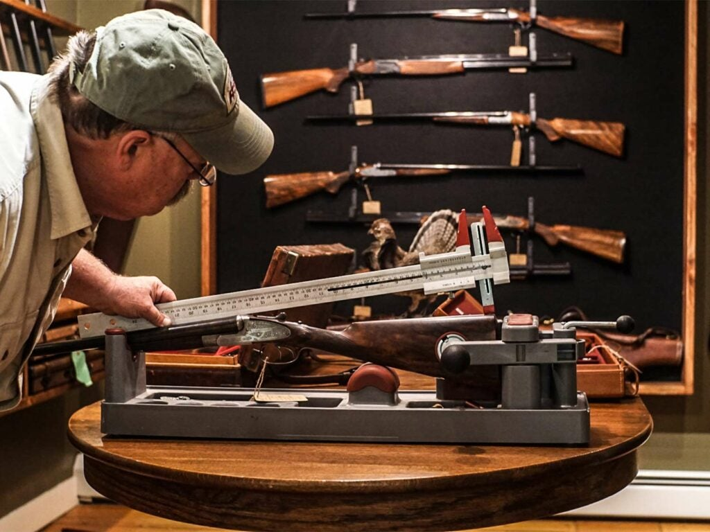 gunsmith measuring shotgun stock