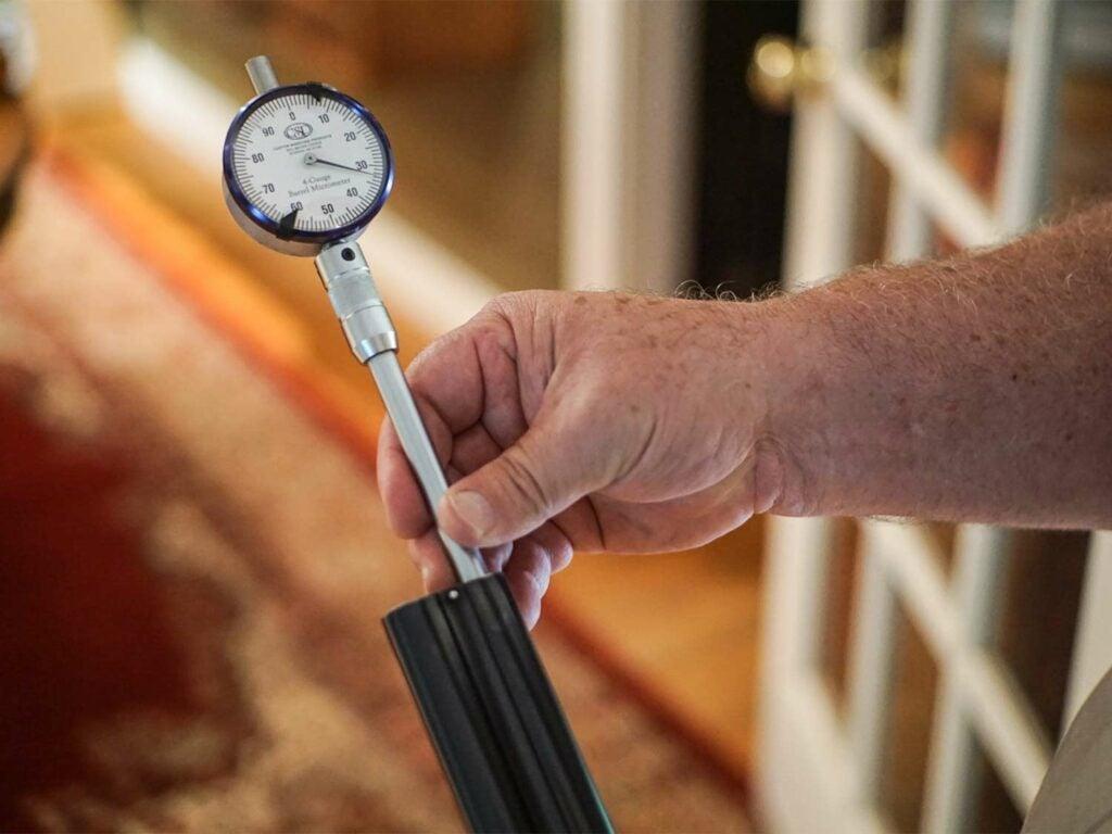 micrometers measuring shotgun barrel wall