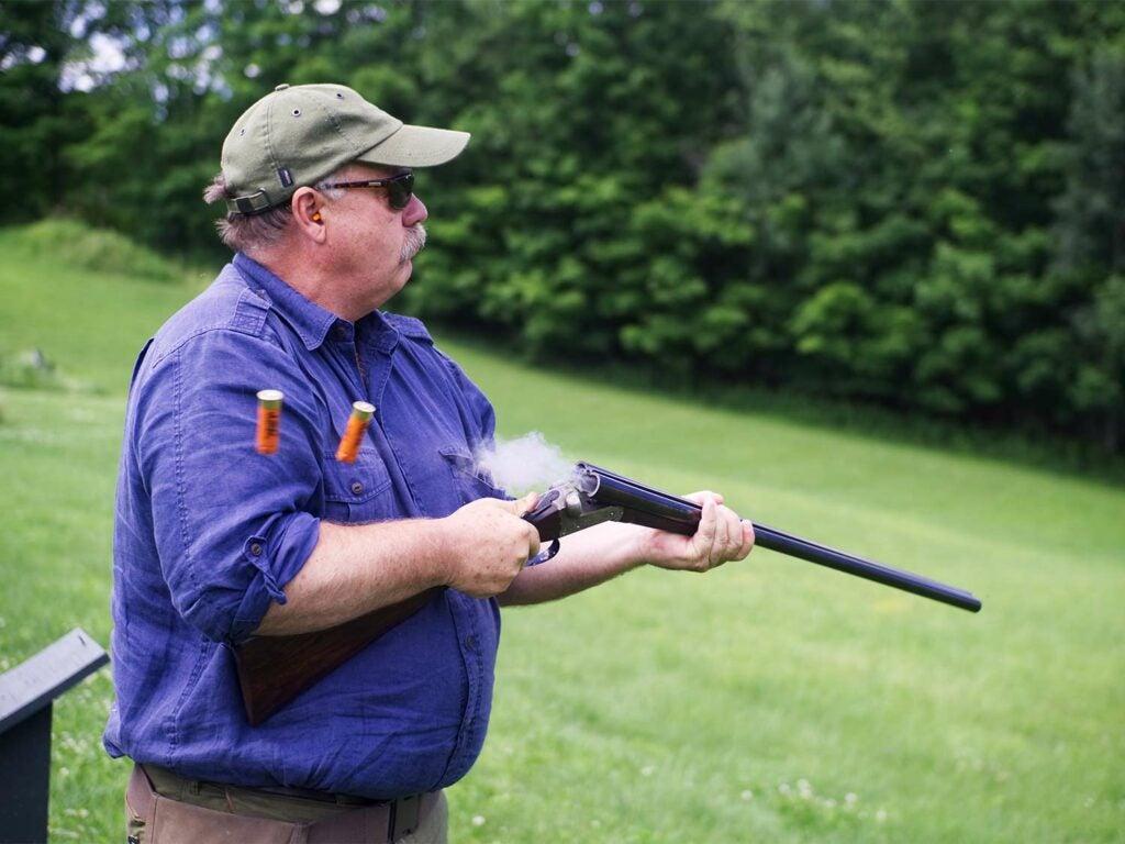 shooter with shotgun emptying barrels
