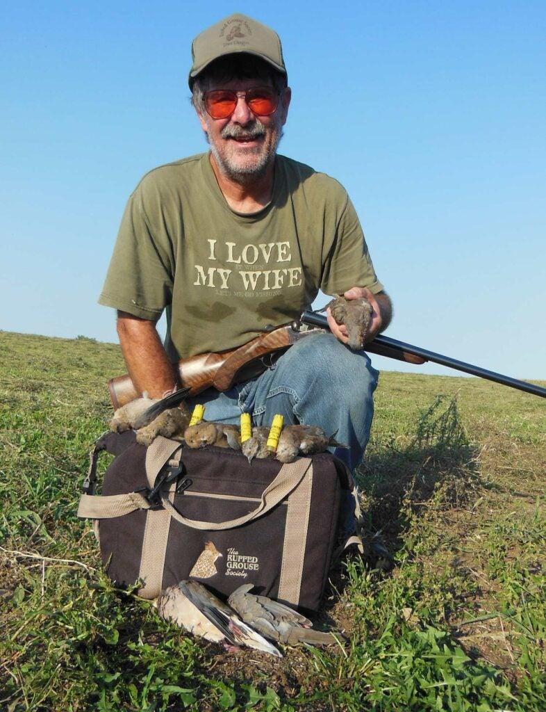 man holding a 20-gauge shotgun and doves