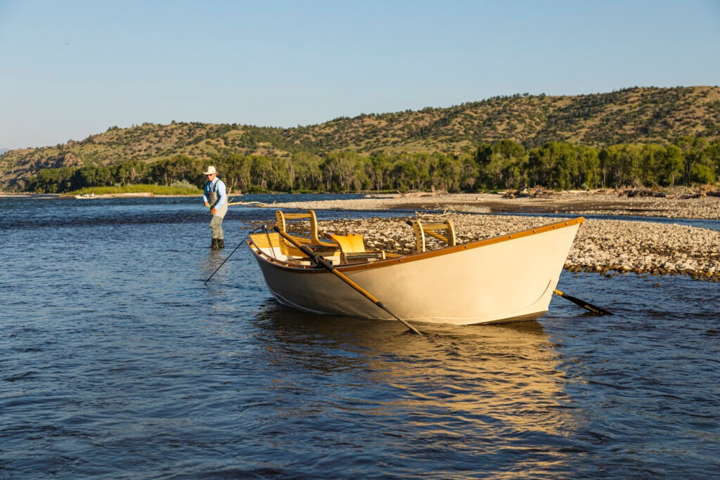 A Boulder Boat Works drift boat waits for a fly angler.