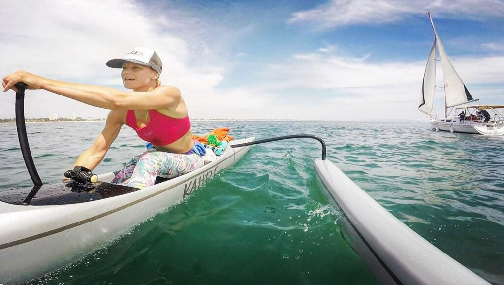 A paddler in the Outrigger Zone Kahele outrigger canoe.
