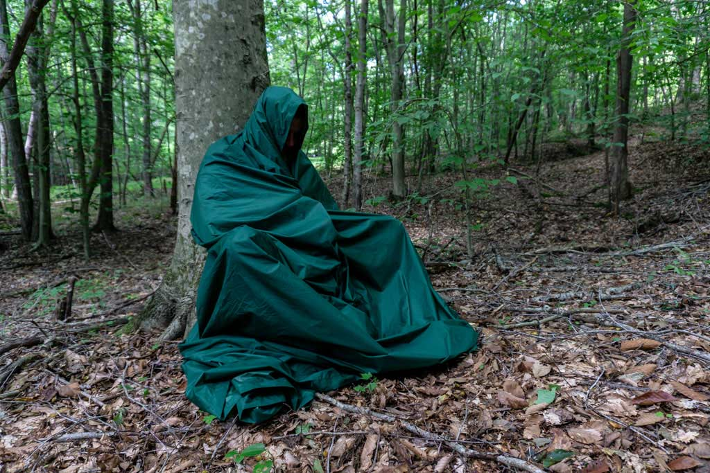 a person wrapped in a tarp