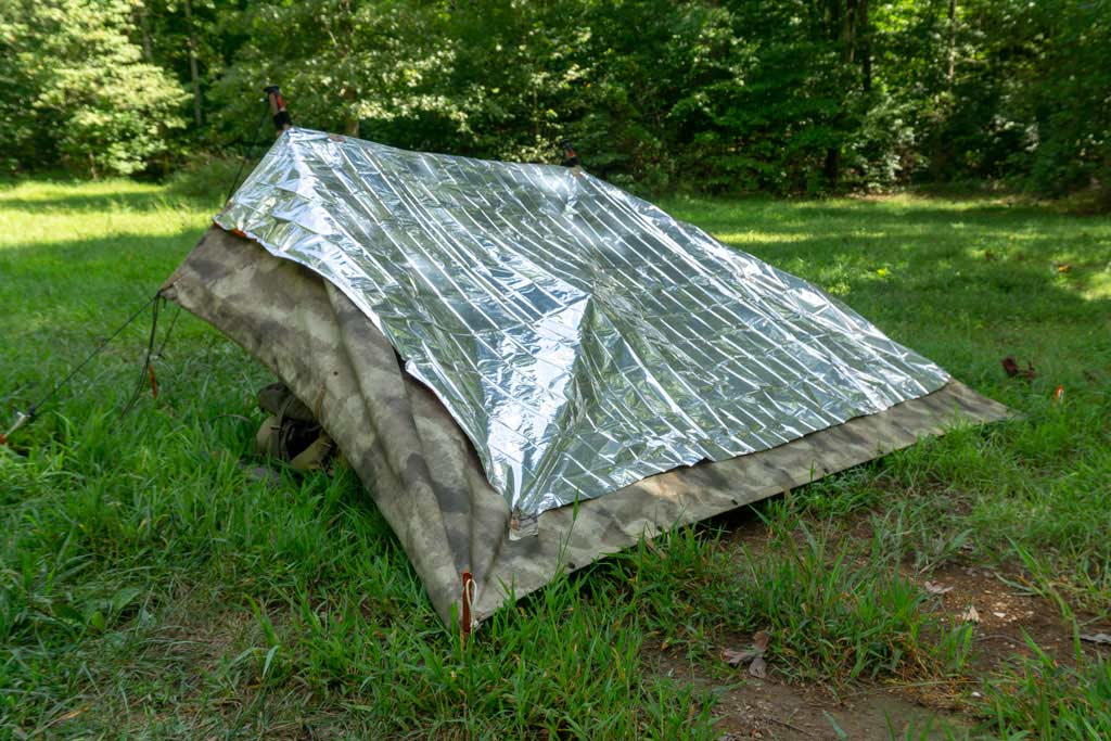 thermal blanket on topo of a lean-to shelter