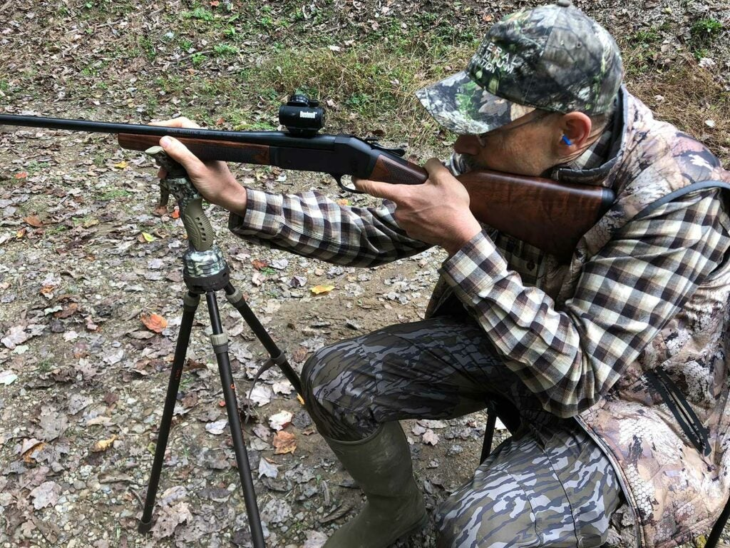 phil bourjaily aiming a shotgun