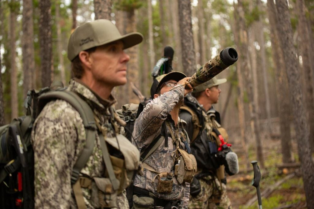 three elk hunters in the woods