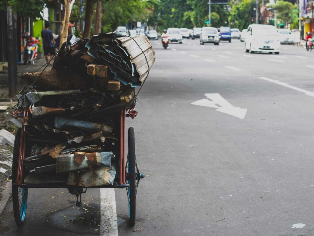 Roadside cart topped with a bundle of junk
