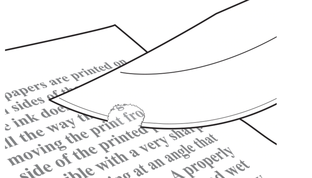 Slice a thin layer of paper from the surface of the page.