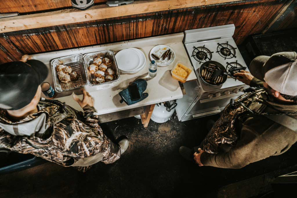 hunters cooking at a small kitchen space