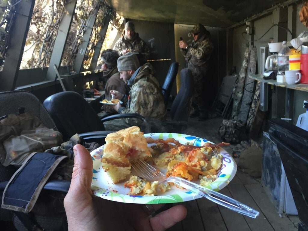 hunters eating in a duck hunting blind