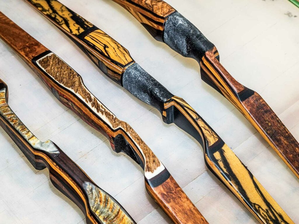 a lineup of traditional custom crafted bows