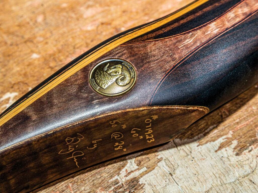 Full Curl recurve bow with a coin embedded in it