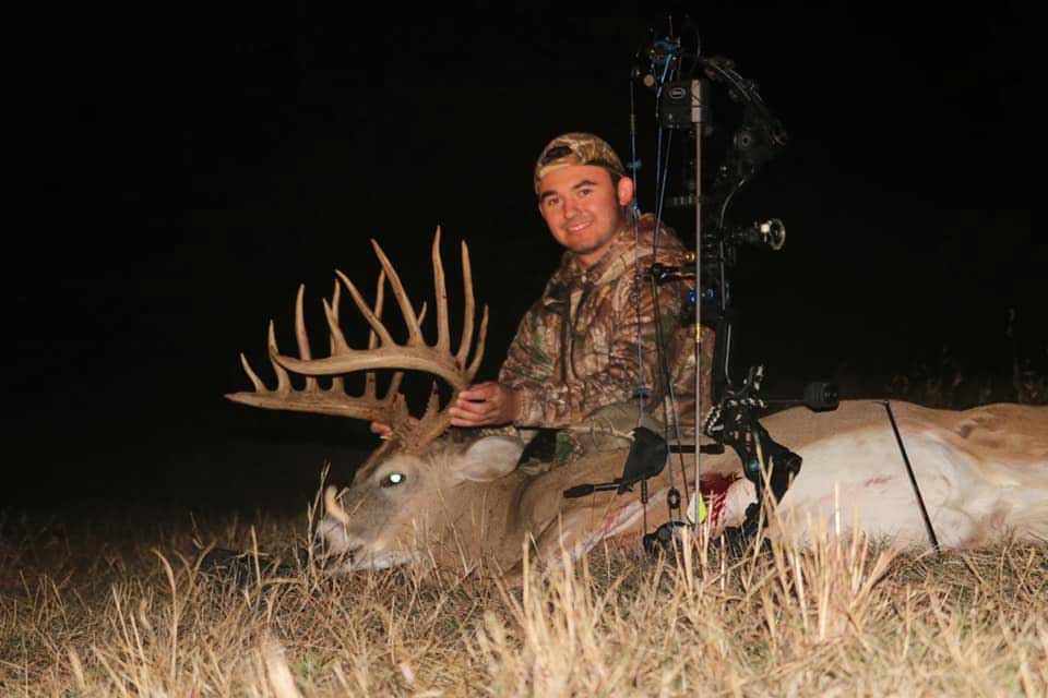 hunter with a whitetail buck