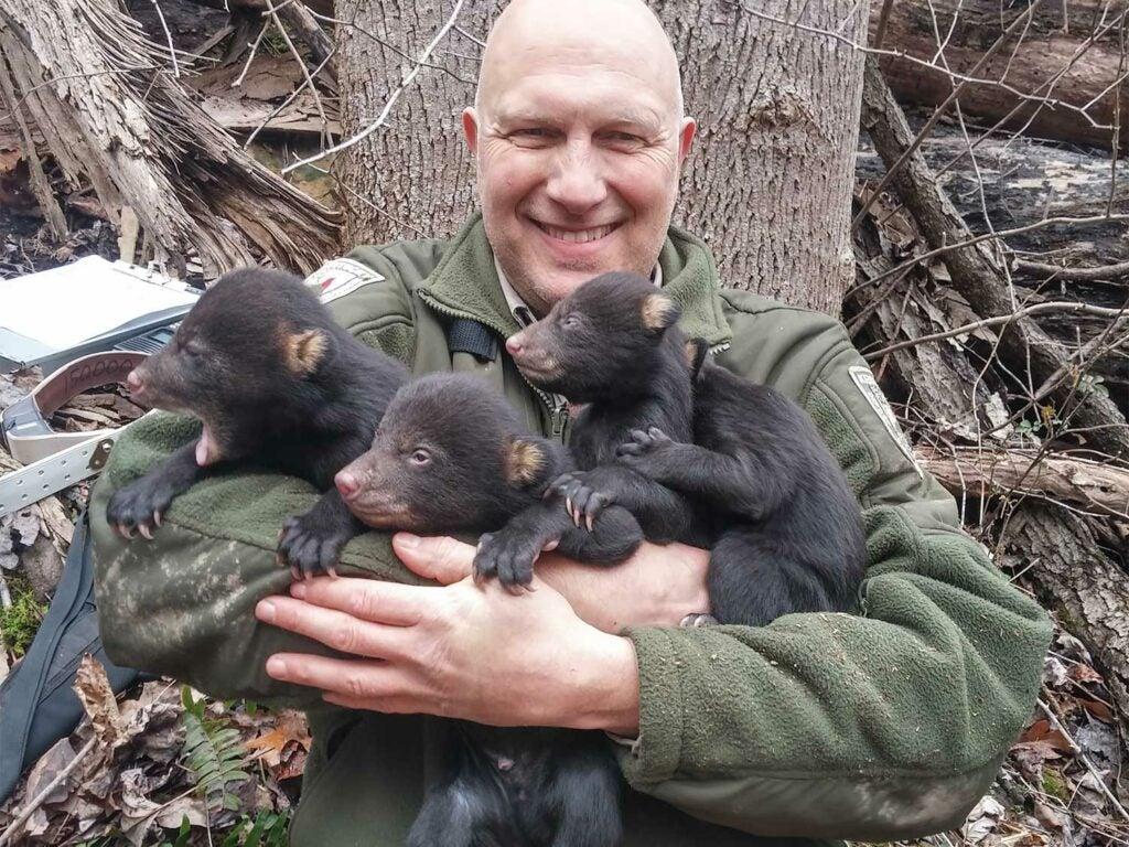 joe lacefield holding bear cubs